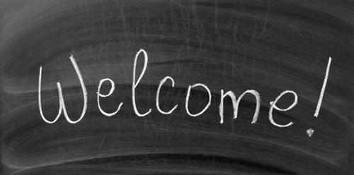 Welcome icon written in chalk on blackboard